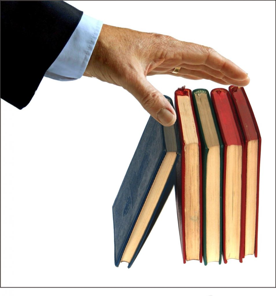 hand-reaching-for-books
